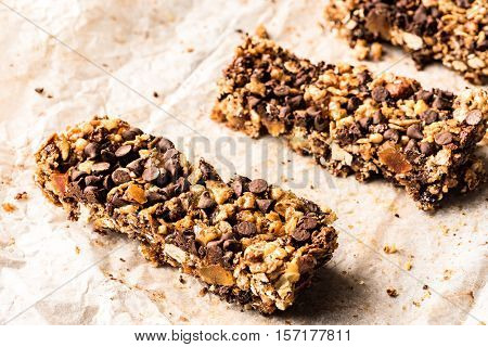 healthy homemade muesli bar with cereals chocolate dropsand copy-space