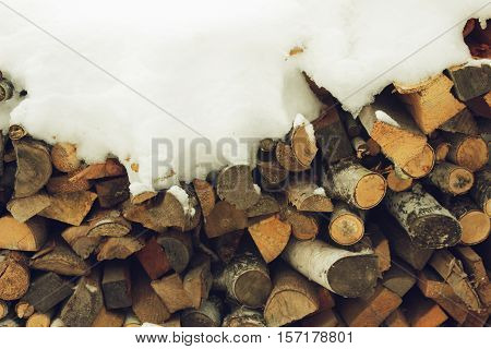 Small woodsheds under snow in the winter