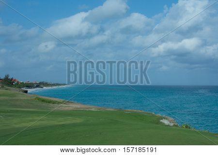 Early sea landscape. Sky, sea, grass.  f/16 1/640 ISO.500 29mm