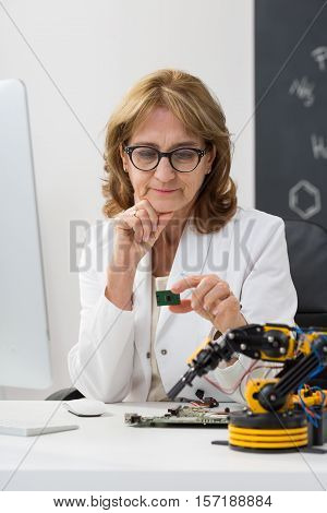Shot of a technical university professor sitting in a classroom