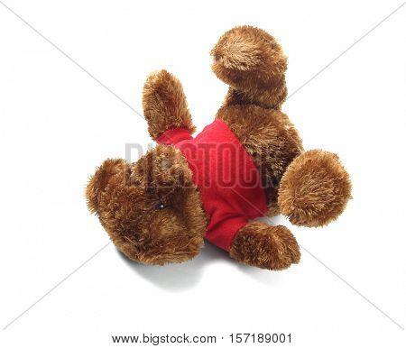 Teddy Bear Soft Toy Lying on White Background