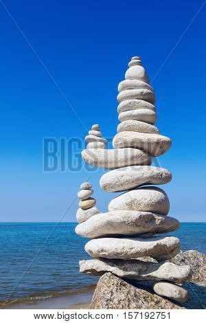 Concept of balance and harmony. Big White rocks zen on the background of sea and blue sky