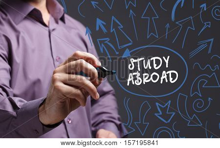 Technology, Internet, Business And Marketing. Young Business Man Writing Word: Study Abroad
