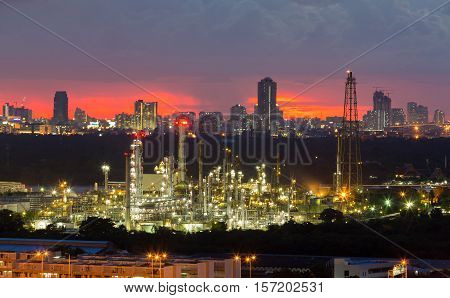 Oil refinery with city downtown background night view