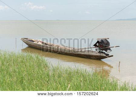 Close up lone row boat on lake