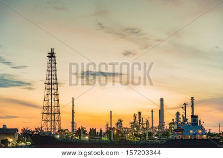 Oil refinery and tower during sunrise background
