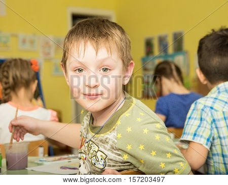 funny children draw paints and pencils brightest pictures in kindergarten - Russia Moscow - February 04 2016