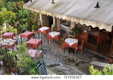 Meteora Greece - Sept 27 2016: Outdoor view of the traditional Greek tavern in Kastraki village