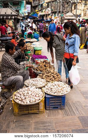 Kathmandu, Nepal - OCTOBER 24, 2016: People selling vegetables at Asan market in central Kathmandu.