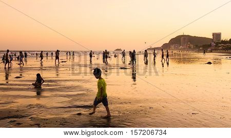 People Relax On The Beach At Sunset In Vung Tau, Vietnam