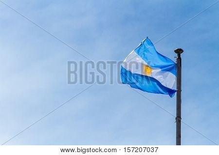 Flag Of Argentina Flaming Against Blue Sky At Buenos Aires