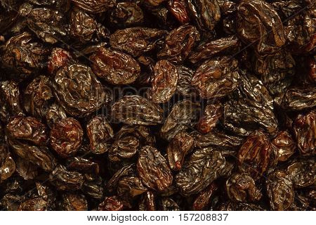 dried black sultana background, pile of raisin photo