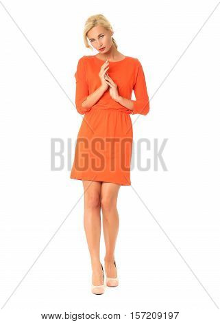 Full Length Of Flirtatious Woman In Coral Dress Isolated On White