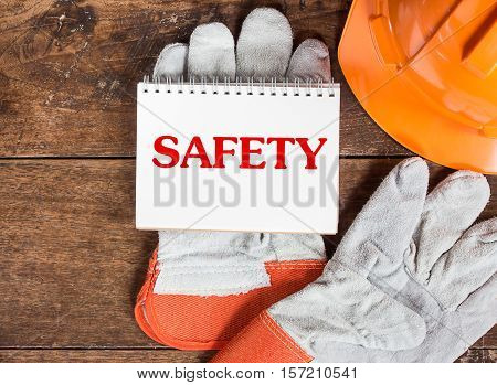 White card in safety glove with the inscription SAFETY