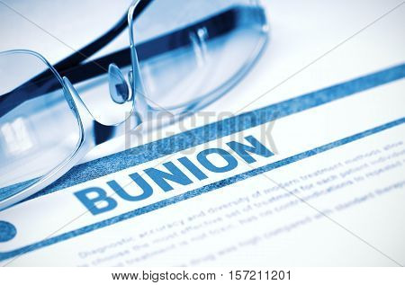 Bunion - Medical Concept with Blurred Text and Specs on Blue Background. Selective Focus. 3D Rendering.