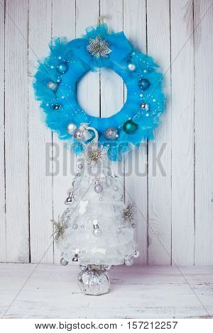 Christmas wreath from blue guipure and silver holiday tree