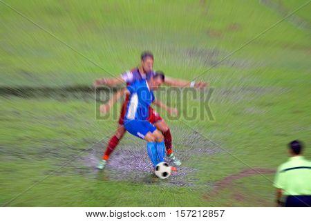 Motion blur photo of Thailand League soccer players