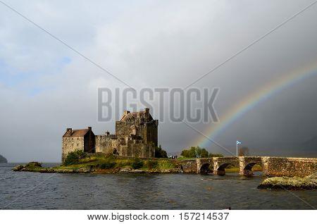 Amazing Eilean Donan Castle with a rainbow in Scotland.