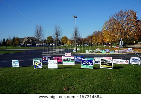 JOLIET, ILLINOIS / UNITED STATES - NOVEMBER 8, 2016: Lawn signs endorse various candidates outside the Wesmere Elementary School, which serves as a polling place on election day.