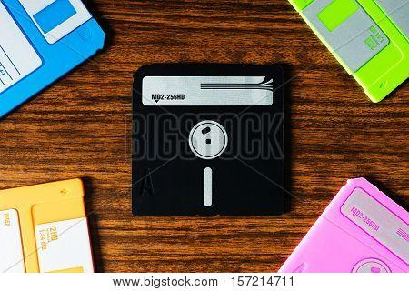 Vintage set of floppy discs on wooden desk background hd