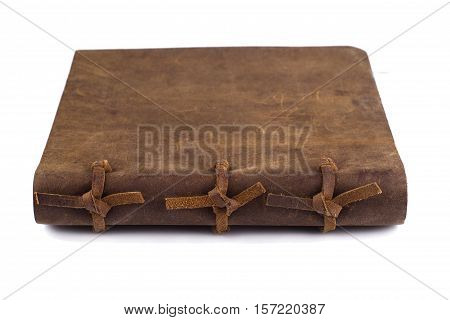 detail of the bindings of a closed leather notebook isolated on white background