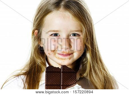 Cute Little Girl Eating Tablet Of Chocolate