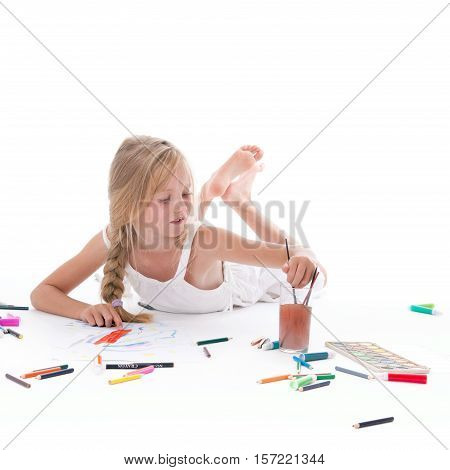 square picture of young girl painting with watercolor on floor of studio against white background