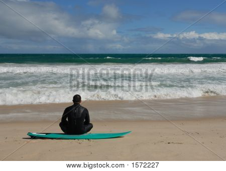 Lone Surfer Sat On His Surf Board