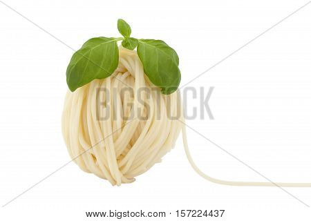 spaghetti in shape ball with fresh basil on white