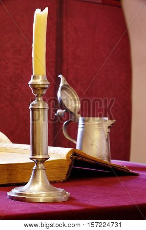 Candlestick and a book still life antique group objects.