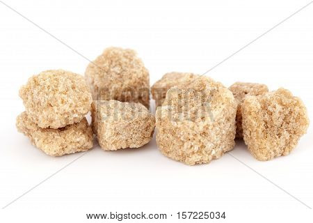 brown sugar in ankles on white background