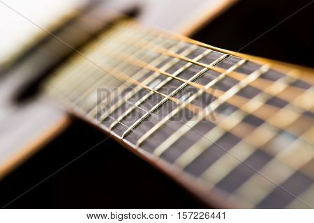 Acoustic guitar close up. Abstract picture with acoustic guitar in close up.