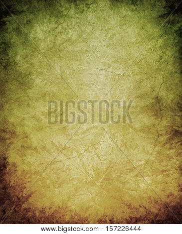 Plant leaf outlines on a grunge paper background with dark edges stains and cracks.