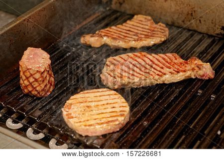 Various meats on electric grill