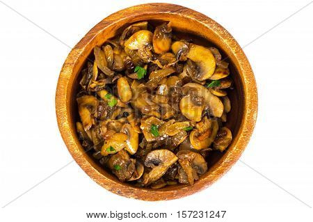 Chopped slices of fried button mushrooms in a wooden bowl. Studio Photo