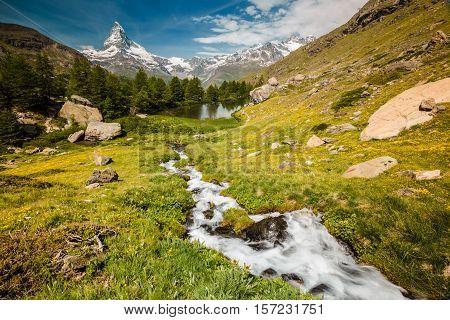 Matterhorn With Stream Flowing To Lake Grindjisee
