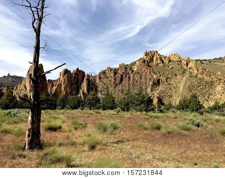 The jagged cliffs of Smith Rocks State Park in Central Oregon on a sunny summer afternoon.
