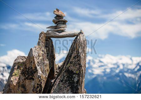 Stones Cairn Bridging Gap Near Eggishorn, Alps
