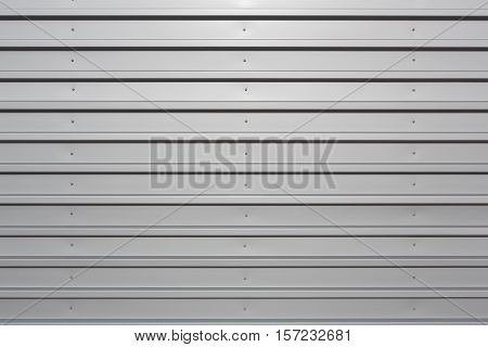 Silver corrugated metal with bolts horizontal orientation