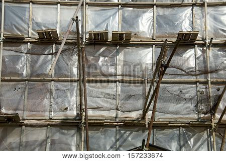 restoration facade of old house under net