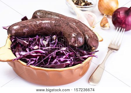 Homemade blood sausage with cabbage on a white background. Studio Photo