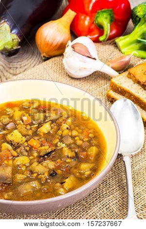 Vegetarian soup with lentils and aubergines. Studio Photo