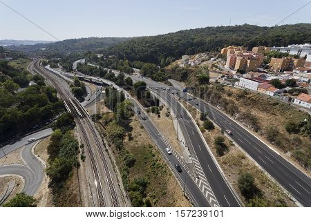 LISBON, PORTUGAL - September 30, 2016: View of the road and railway infrastructure in the Alcantara Valley towards the south of the Aqueduct of the Free Waters in Lisbon Portugal