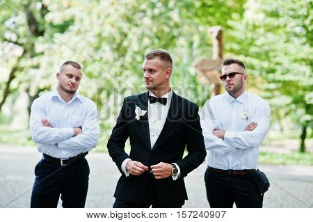 Personable Groom With Best Mans Or Groomsman Posed On Park At Wedding Day.