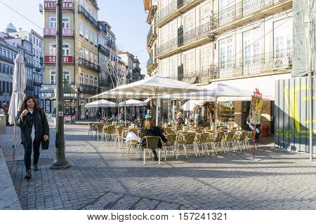 PORTO, PORTUGAL - November 18, 2016. Street view of Open-air cafes in Porto, Portugal, Europe, is the second largest city in Portugal, has a population of 1.4 million.