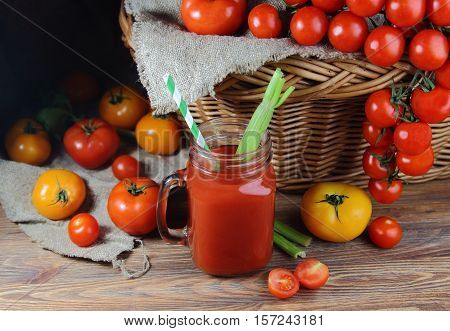 tomato juice in a mug with wicker basket and fresh tomatoes