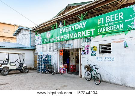 Placencia, Belize - August 29 2016: Supermarket storefront in Caribbean town of Placencia, Belize, Central America