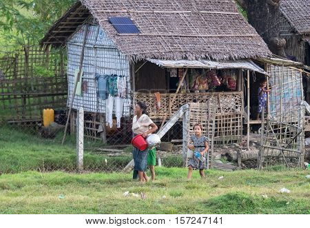 Sittwe - October 25 2016: Traditional housing with straw roof at the outskirts of Sittwe the capital of the Rakhine State in Myanmar a state with little development but with endless ethnic and religious conflicts.
