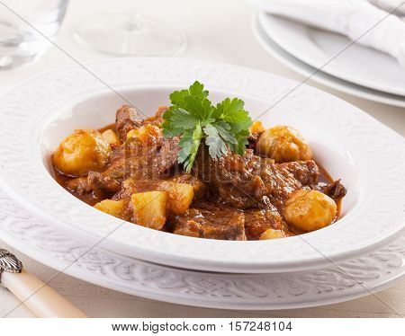 Traditional Hungarian goulash made with beef tomato pepper chili smoked paprika.
