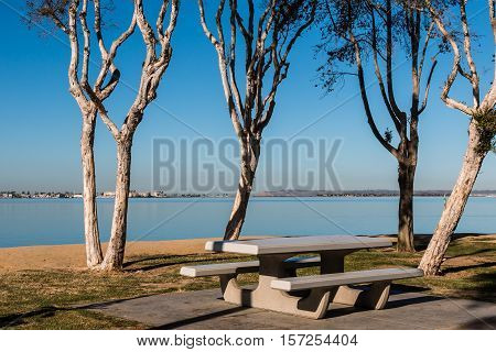 Picnic area at Chula Vista Bayfront park with San Diego bay and Point Loma in the background.